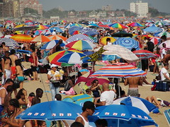 Mango Lady at Coney beach (agent j loves nyc) Tags: newyorkcity beach brooklyn coneyisland coney atlanticocean beachumbrella beachgoers beachumbrellas