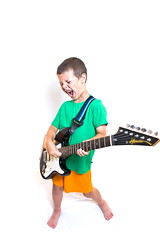 Born to rock! (Mr Din) Tags: cactus orange white green shirt youth studio fun kid guitar flash whitebackground short wireless clment 2010 electricguitar strobist cactusv4