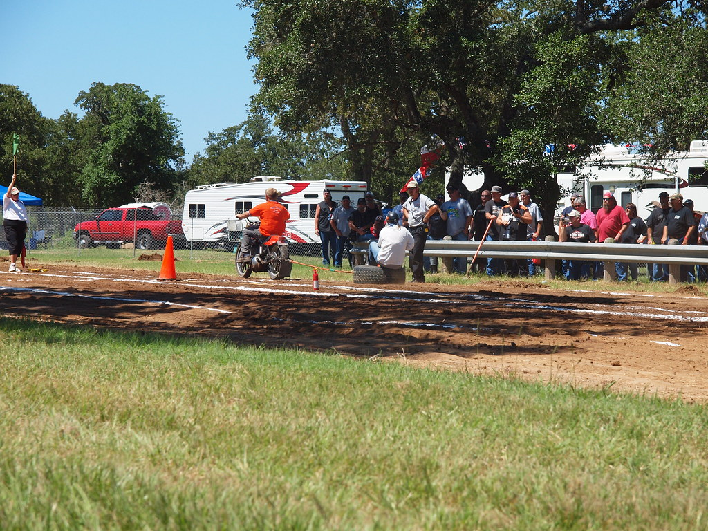 Columbus Texas Easyriders Rodeo Tour & Motorcycle Rally The tire ride July 31 2010 Guys  with motor bikes dragging their ladies sitting on old tires race