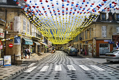 Street in Montignac - 1 (Ben Heine) Tags: street camera bridge light party wallpaper sky copyright france art cars tourism colors clouds composition print poster lens landscape photography lights vanishingpoint focus holidays shadows dof village cloudy pov earth lumire decorative space flag horizon country transport decoration perspective arts creative atmosphere tunnel dordogne celebration spots ciel montignac terre pont prigord conceptual taches rue reproduction connection contrejour ombres paperflower cs4 makadam acquitaine benheine flickrunited samsungnx10 infotheartisterycom