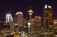 Downtown Calgary at Night (Jim Boud) Tags: travel canada calgary tower skyline architecture night skyscraper canon dark lens landscape eos lights hotel is cityscape apartment nightshot crane wideangle landmark lookout canadian observatory alberta northamerica layers usm dslr 1785mm digitalrebel digitalslr efs1785mmf456isusm province calgarytower litup imagestabilization imagestabilized 550d jimboud t2i jamesboud eos550d kissx4 photomatixesposurefusion