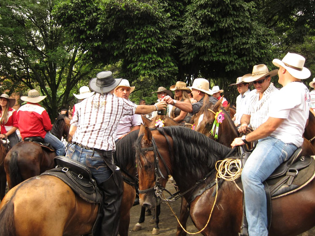 Riders, both men and women, passed around bottles of liquor to drink during the parade. Police on horseback were in the mix to keep the event under control.