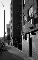 7:00 PM (Rafakoy) Tags: street shadow people blackandwhite bw sun white ny newyork black building brick film skyline 35mm 50mm photo chelsea kodak manhattan bricks f100 monotone negative epson kodakbw400cn meatpackingdistric c41 realphotography nikkoraf50mmf18d epsonv600 epsonperfectionv600photo epsonperfectionv600 aldorafaelaltamirano rafaelaltamirano aldoraltamirano