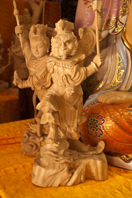 Original wood carving of famous Monkey Prince, Penang, Malaysia