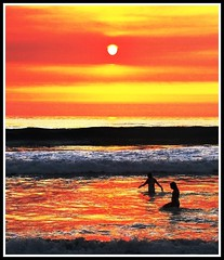 Summer Bliss Light, California Coast (moonjazz) Tags: ocean california travel pink blue light sunset red sea sky orange woman white man black color nature silhouette yellow last wow wonder landscape gold coast bath artist colours peace shine time earth tide unity horizon rich dream wave atmosphere august romance sensual human fade prize beyond forever swimmers bliss glimmer impressionist perfection endofdays