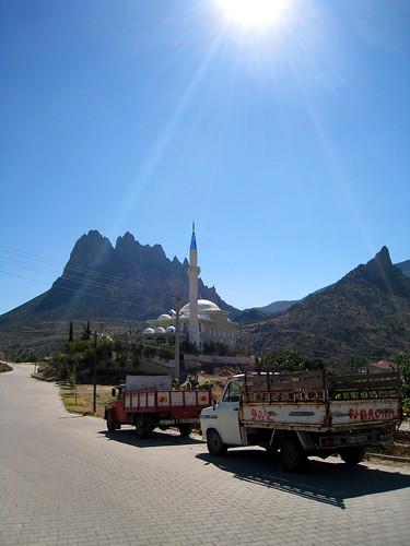 Mosque, trucks and hill at Mihalgazi