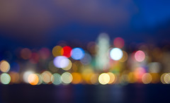 Hong Kong Island Skyline in Bokeh (Jim Boud) Tags: ocean china travel pink light red sky orange white seascape abstract macro reflection building water colors yellow skyline clouds skyscraper canon lens landscape asian island hongkong eos prime coast focus shiny colorful asia downtown cityscape dof shine purple nightshot pacific bright cloudy bokeh dusk metallic smooth depthoffield fixed 24mm dslr digitalrebel seashore photoart digitalslr f28 ef hongkongisland waterscape nightexposure artisticphotography partlycloudy victoriaharbour victoriaharbor asiapacific stepdown largeaperature jimboud t2i smallfstop jamesboud eos550d kissx4