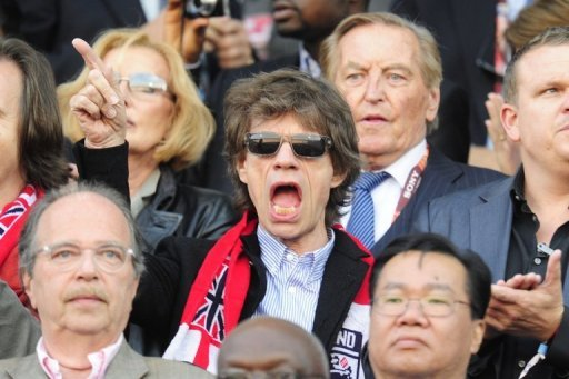 Thumb Mick Jagger from Rolling Stones watching the game England versus Germany