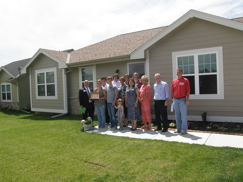 USDA Housing Administrator Tammye Trevino (fifth from right) Homeowners, builders and USDA officials stand in front of a home in Glenwood, Iowa financed with assistance from USDA Rural Development.