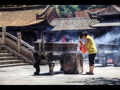 Wishing (Kaj Bjurman) Tags: china woman yellow temple eos prayer 5d kunming hdr kaj wishing markii cs3 photomatix bjurman