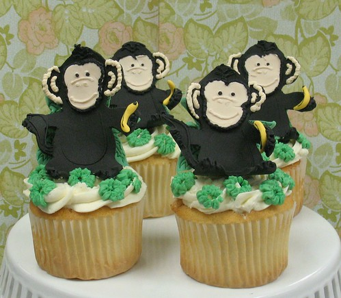 [Image from Flickr]:Large cupcakes with vanilla buttercream and fondant monkey decorations $51/dz