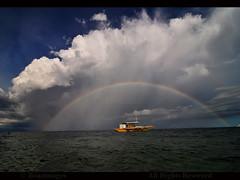 THE PHILIPPINES (BoazImages) Tags: ocean travel sunset beauty weather landscape boat rainbow philippines dramatic stormy cebu visayas thephilippines worldlocations boazimages