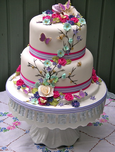 Bright summer blooms wedding cake