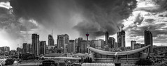 The Calgary Tower (Jim Boud) Tags: travel red sky blackandwhite bw panorama white canada black calgary tower monochrome skyline architecture clouds skyscraper canon lens landscape eos grey mono hotel saddledome cityscape apartment cloudy crane stadium gray wideangle landmark lookout canadian observatory alberta western northamerica rodeo layers usm dslr 1785mm digitalrebel photoart efs digitalslr hdr highdynamicrange efs1785mmf456isusm province stampede calgarytower artisticphotography partlycloudy multipleexposures blendedexposure stormyskies photomatix pengrowthsaddledome 550d jimboud t2i photomatixhdr topazadjust jamesboud eos550d kissx4
