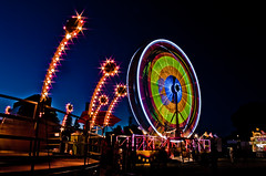 The Ferris Wheel (Billy Wilson Photography) Tags: longexposure carnival summer sky people ontario canada motion blur night digital canon dark fun eos rebel lights movement lowlight circus july kitlens fair event nighttime ferriswheel bluehour xs saultstemarie northernontario algoma rotaryfest diffractionstars billywilsonphotography saultphotographer processedforuse