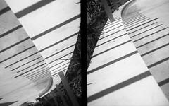 I'm on your side now (QsySue) Tags: blackandwhite abstract lines bench concrete diptych shadows angles 35mmfilm poles orangecounty anaheim olympuspenee efke25 developedathome 35mmcamera halfframecamera titleisajessesykeslyric