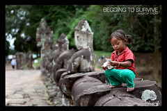 Survive in Angkor THom (Nizam Photographics) Tags: kids canon cambodia mark ii 5d angkor wat photojournalist