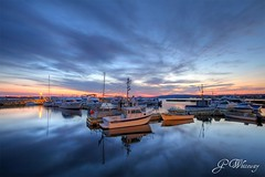 Marina (gwhiteway) Tags: ocean morning canada reflection marina sunrise newfoundland boats harbor ship harbour soe tanker cbs conceptionbay conceptionbaysouth foxtrap justclouds colorphotoaward platinumpeaceaward mygearandmepremium mygearandmebronze mygearandmesilver