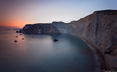 The Curved Cliff (Tommaso Renzi) Tags: longexposure sunset sea italy rome water landscape nikon rocks tramonto mare latina paesaggio ponza lazio sabaudia circeo sigma1020 chiaiadiluna bwnd110 sunsetponza tramontoponza