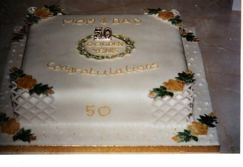 Square 50th wedding anniversary cake with flowers and piping decoration