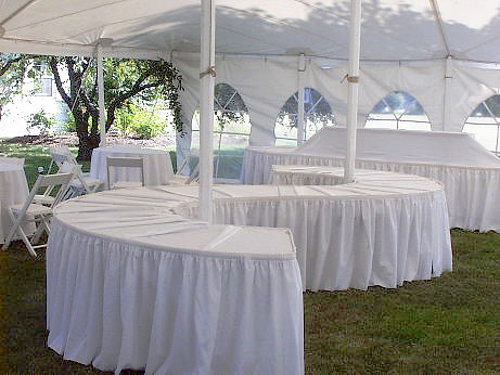 Dressed Serpentine Tables