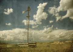 two tanks (jssteak) Tags: sky windmill grass clouds rural canon fence landscape colorado dirt rusted planes hdr watertanks thunderstorms pawneenationalgrasslands pawneebuttes ranchland necolorado t1i