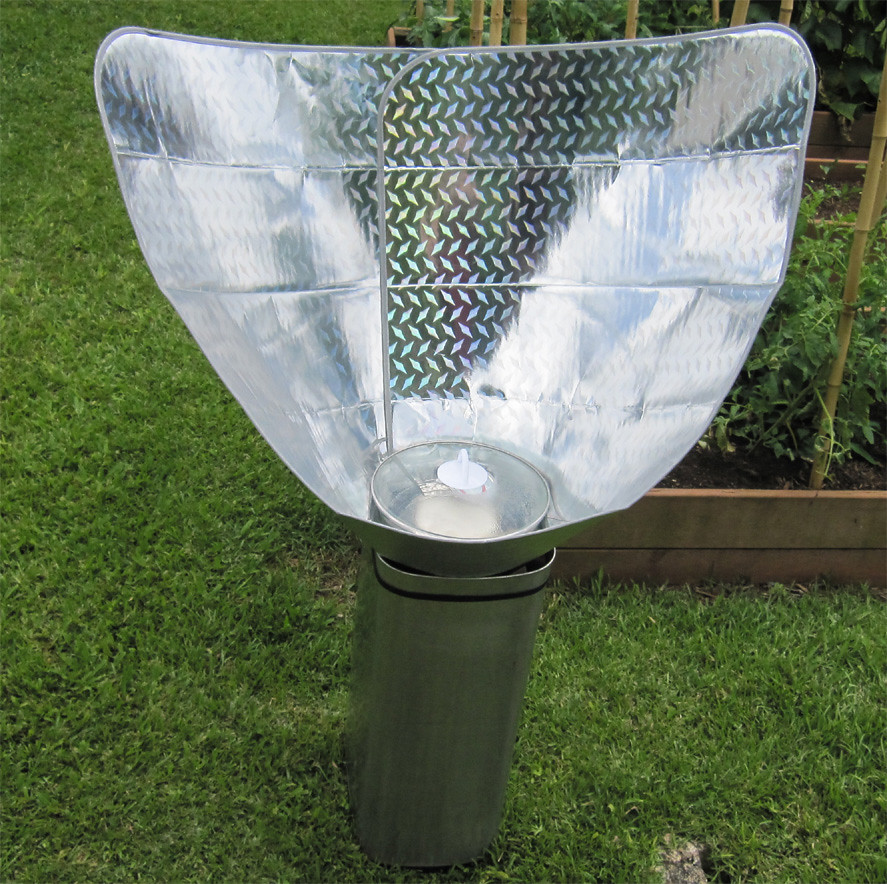 Solar funnel cooker with diamond plate car window shade