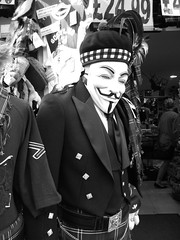Mc V for McVendetta (byronv2) Tags: blackandwhite bw monochrome festival shop comics scotland blackwhite edinburgh kilt scottish fringe v royalmile vforvendetta oldtown tartan 2010 highlanddress edinburghfestivalfringe