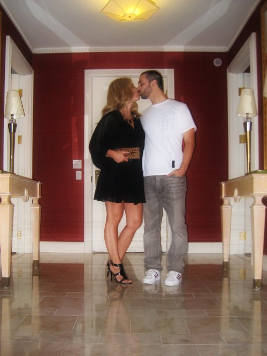 kissing in room foyer, dressed up for dinner, little black dress, mara hoffman dress, sheer black mini