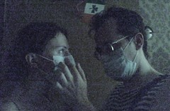 Stanny adjusting Mary's Mask (Real Distan) Tags: summer home smog mary masks 2010 stanny rukenau