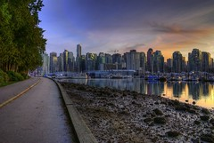 On the Seawall (Brandon Godfrey) Tags: vancouver britishcolumbia bc stanleypark canada seawall pacificnorthwest evening sunset dusk city skyline urban metro metropolis buildings coal harbour harbor reflections towers big downtown water beach rocks trees cloud clouds hdr highdynamicrange photomatix tonemapped tonemapping sony a300 alpha northamerica photography landscape cityscape marina boats yachts color colour colors colours colorful colourful blue shangrila crane scene scenery scenic beautiful photo photos picture pics pic pictures amazing wonderful wallpaper allrightsreserved copyright glass beauty canadian westend muddy skyscrapers challengegamewinner