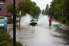 ooohhh shit!!!!! (MasterWillems) Tags: road blue red green water rain yellow kids cycling jumping fload splashes carspeople floaded