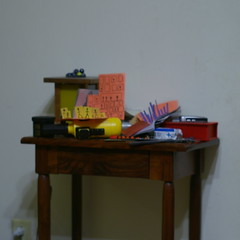 Still life with lamp, toys, and artworks