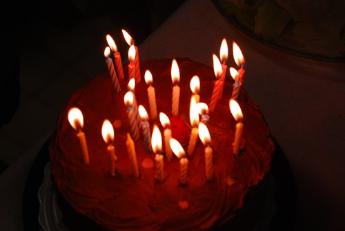 24 candles for 29 years; or smiley face