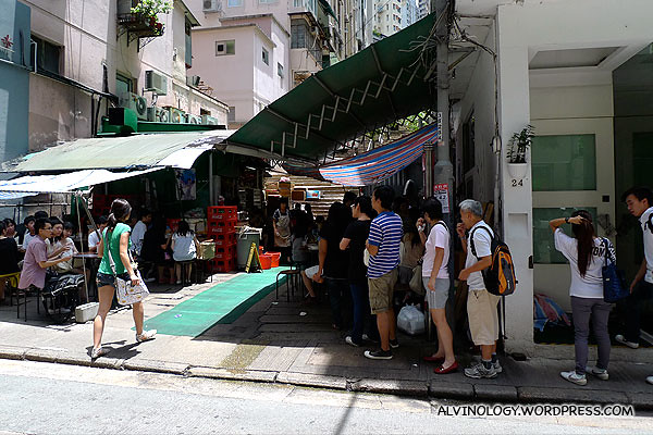There are also many famous food stalls along the street which attract long queues