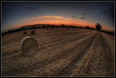 Night shift end (Ivorbean) Tags: morning sky sunlight field sunrise fire nikon moody shadows cloudy dusk straw nightshift gloucestershire urbanexploration orangesky redsky bales hdr atmospheric roundbales burntsky d700 ivorbean