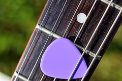 Relaxation (Terri McClanahan) Tags: macromondays relaxation guitar sixstring purple outdoors bokeh musicalinstrument strings macro