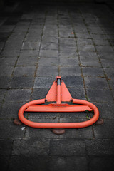 (andersdenkend) Tags: street red orange stone dark parking barrier asphalt blockade vignetting brightcolor nikkor50mmf12 colorwhore nikond700