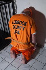 LUBBOCK_1290 (skinmate) Tags: uniform prison jail inmate restraints