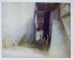 Woman Next Door (Sacha Bertrand) Tags: door woman grass stairs polaroid femme next porte herbe escaliers
