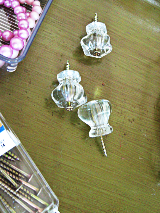 vintage glass drawer pulls as necklace organizer