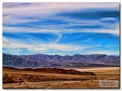 Death Valley Land & Sky 2 (GlixPix) Tags: sky mountain mountains clouds landscape nationalpark view desert dramatic gimp wideangle bluesky olympus erosion deathvalley badlands drama desertview desertmountains clearingstorm greatphotographers vob supershot olympuse30 glixpix kevindrenz zuiko1454f28ii kevinrenz kdrenz