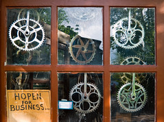 Woodstock_02 (Chris Protopapas) Tags: window bicycle shop hope pentax business repair recycle recycling woodstock chainwheel chainring entrepreneur crankset pentaxk10d smcpda1855mmf3556 pentaxart visipix