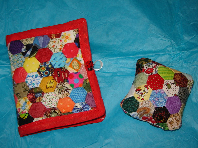 Half inch hexies turned into a needle case and pin cushion