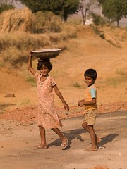 indnr7000050.jpg (Keith Levit) Tags: girls boy india boys girl yellow walking children photography asia child fineart country bowl countries balance bowls levit keithlevit keithlevitphotography