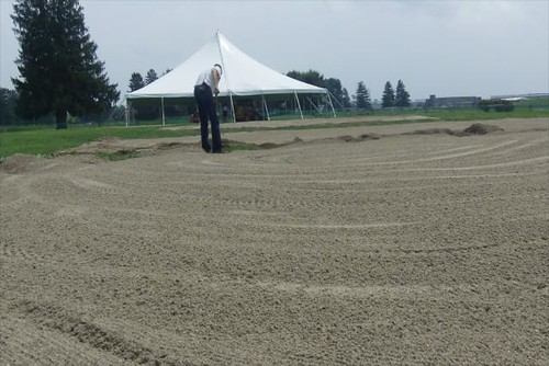 Laying down sand for the Brickyard Beach Bash