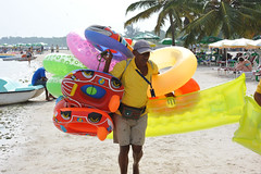People making their living, selling (vinylmeister) Tags: people beach colors photography year streetphotography july 2010 photocamera bocachica colourfull dominicanrepublicrepublicadominicana nikond700 nikonafnikkor85mmf14dif citiesplaceslocation streetworkersstreetsellers