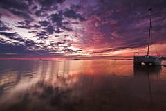 Pobre de mi (José Andrés Torregrosa) Tags: sea clouds marina canon barco murcia amanecer nubes catamaran marmenor cartagena abandono losalcazares 40d tokina1116