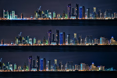 Doha Night Skyline (christian.senger) Tags: city travel blue light sea sky urban panorama white black water silhouette yellow architecture night digital geotagged grey bay construction nikon asia neon waves glow purple crane outdoor gray highrise distance hdr doha qatar lightroom d300 hugin photomatix christiansenger:year=2010 gettyvacation2010