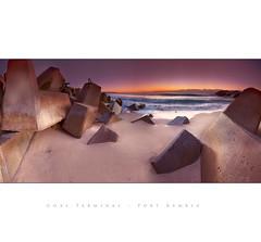 Coal Terminal Port Kembla (fischstarr) Tags: longexposure pink sea beach water yellow clouds sunrise nikon rocks waves pano tripod sigma 1020mm stitched wollongong 01megapixels wpm d40x singhrayfilters
